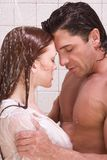 Man and woman in love are kissing in shower Stock Photos