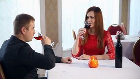 Man and woman love romantic evening in a restaurant drinking wine, Valentine's Day. Man and  woman love romantic evening in a restaurant drinking wine, Valentine stock footage