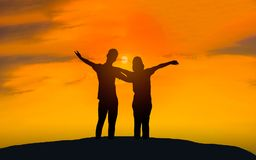 Man and woman in love . Silhouette photo. Man and woman in love. They are standing and see the sun set. Woman wearing a hatand man Man hugging woman.Photo Royalty Free Stock Photo