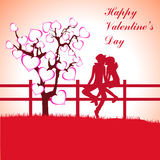 Man, Woman and Love tree with hearts on a grass Royalty Free Stock Images