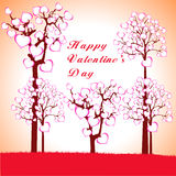 Man, Woman and Love tree with hearts on a grass Royalty Free Stock Photos