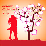 Man, Woman and Love tree with hearts on a grass Stock Images