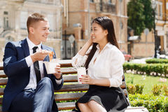 Man and woman during lunch break in park Stock Image