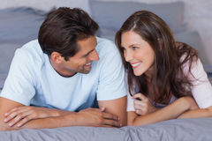 Man and woman lying on bed Royalty Free Stock Photo