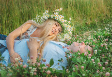 Man and a woman lying down on grass. Stock Photo
