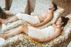 Man and woman lying down together Stock Photos