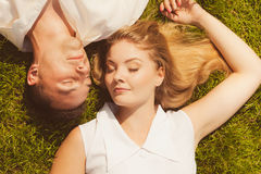 Man and woman lying on grass having date Royalty Free Stock Photos