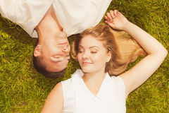 Man and woman lying on grass having date Stock Photography