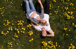 Man and woman lying on the grass Royalty Free Stock Photo