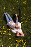 Man and woman lying on the grass Royalty Free Stock Images