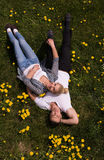 Man and woman lying on the grass Stock Photography