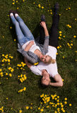 Man and woman lying on the grass Royalty Free Stock Photography