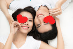 Man and woman lying head to head on the blanket Royalty Free Stock Image