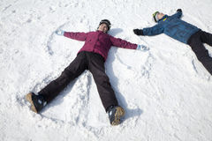 Man and Woman Lying on the Snow Making Snow Angel Stock Image