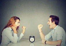 Man and woman mad angry with each other having disagreement screaming. Business competition. Man and women mad and angry with each other having disagreement Stock Photo