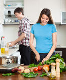 Man and the woman make dinner for himself Stock Photo