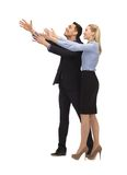 Man and woman making a greeting gesture Stock Images
