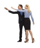 Man and woman making a greeting gesture Royalty Free Stock Image
