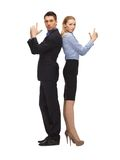 Man and woman making a gun gesture Stock Image