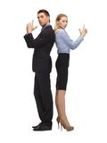 Man and woman making a gun gesture Stock Photo