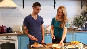 Man and woman making hamburgers stock footage