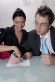Man and woman making a list Royalty Free Stock Photos
