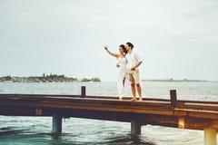 Man and woman making selfie on bridge Royalty Free Stock Photo