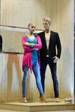 Man and woman mannequin in fashion shop window Stock Image