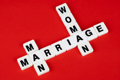 Man, woman and marriage. Words on red background Stock Photos