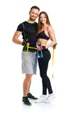 Man and woman with measuring tape on the white background Royalty Free Stock Photos