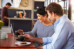 Man and woman meeting over coffee in a restaurant Royalty Free Stock Photos
