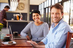 Man and woman meeting over coffee in a restaurant Royalty Free Stock Images