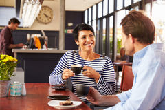 Man and woman meeting over coffee in a restaurant Stock Images