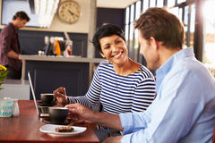 Man and woman meeting over coffee in a restaurant Stock Photos