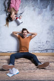 Man and woman with megaphone Stock Image