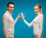 Man and woman with modern gadgets Royalty Free Stock Photography