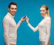 Man and woman with modern gadgets Stock Photos