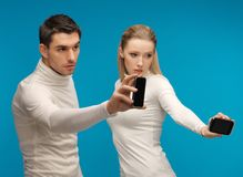 Man and woman with modern gadgets Royalty Free Stock Image