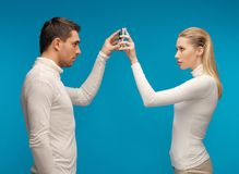 Man and woman with modern gadgets Royalty Free Stock Images