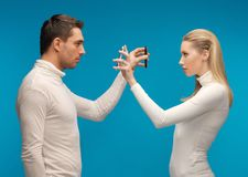 Man and woman with modern gadgets stock photography