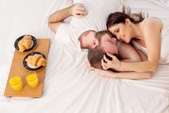 A man with a woman in the morning woke up to breakfast in bed Royalty Free Stock Image