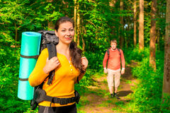 Man and woman in the morning in the woods Stock Photo