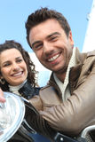 Man and woman on motorbike Stock Photography