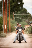 Man and Woman on Motorcycle Stock Photos
