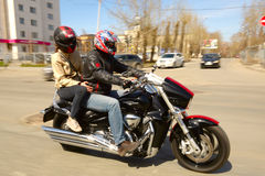 Man and woman on a motorcycle Stock Images