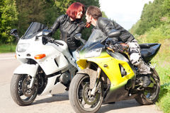 Man and woman on motorcycles Royalty Free Stock Image