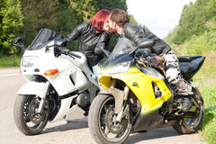 Man and woman on motorcycles Royalty Free Stock Images