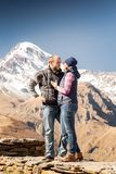 Man and woman in the mountains Stock Photo