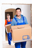 Man and woman moving in new home with boxes Stock Photography
