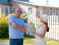 Man and woman near gate of  home Royalty Free Stock Photography